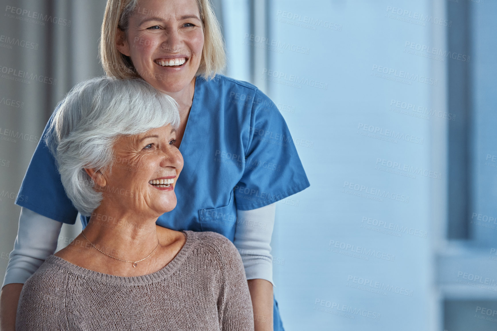 Buy stock photo Shot of a nurse pushing her senior patient in a wheelchair