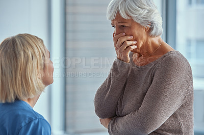 Buy stock photo Shot of a senior woman receiving bad news during a conversation with a nurse