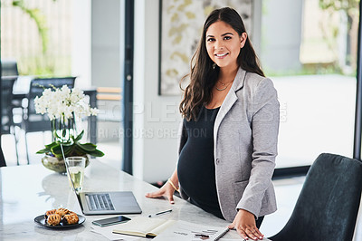 Buy stock photo Portrait of a pregnant young woman working from home