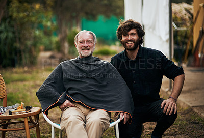 Buy stock photo Cropped portrait of a handsome young man sitting outside with his elderly father