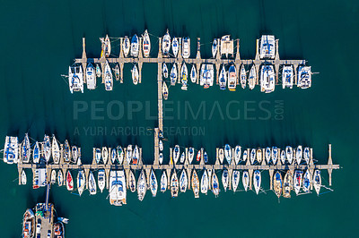 Buy stock photo High angle shot of boats at a seaside harbour