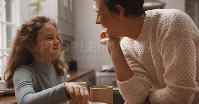 Buy stock photo Cropped shot of a little girl and her mother having hot chocolate at home