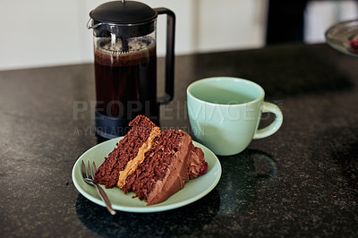 Buy stock photo Shot of chocolate cake served with coffee on a kitchen counter at home