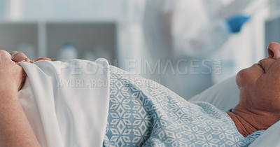 Buy stock photo Shot of a senior woman lying in a hospital bed