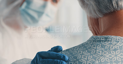 Buy stock photo Shot of a doctor in a hazmat suit comforting a senior patient during her consultation
