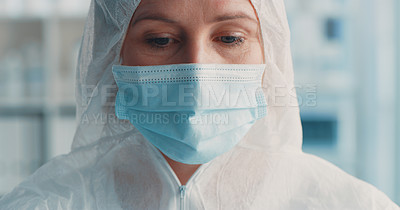 Buy stock photo Shot of a masked doctor wearing a hazmat and face mask