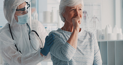 Buy stock photo Shot of a doctor in a hazmat suit comforting a coughing senior patient