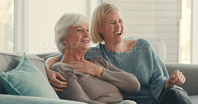 Buy stock photo Shot of a senior woman and her daughter watching tv together at home