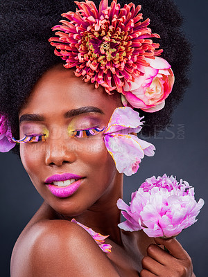 Buy stock photo Studio shot of a beautiful young woman posing with flowers in her hair
