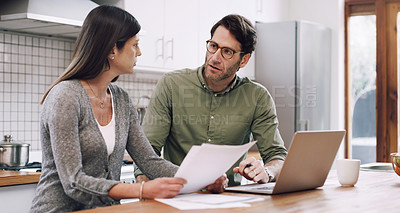 Buy stock photo Cropped shot of a couple using their laptop while going through some paperwork