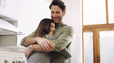 Buy stock photo Cropped shot of a man embracing his wife at home