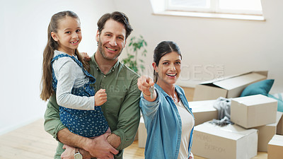 Buy stock photo Shot of a couple and their daughter moving into their new home