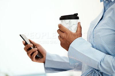 Buy stock photo Cropped shot of an unrecognisable businesswoman using a smartphone and having coffee