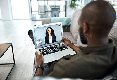 Buy stock photo Shot of a young businessman having a video call with his colleague while working from home