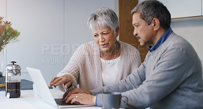 Buy stock photo Shot of a senior couple using a laptop together at home