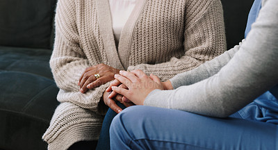 Buy stock photo Cropped shot of a nurse holding hands with a senior woman in a nursing home