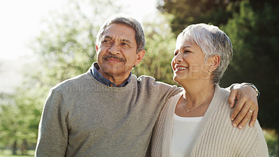 Buy stock photo Shot of a happy senior couple going for a relaxing walk in the park