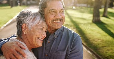 Buy stock photo Shot of a happy senior couple spending a relaxing day in the park