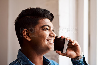 Buy stock photo Cropped shot of a young businessman talking on his cellphone