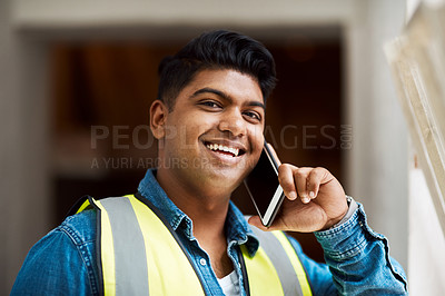 Buy stock photo Cropped shot of a engineer talking on his cellphone while on a construction site