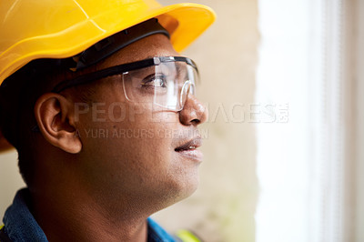 Buy stock photo Shot of a engineer wearing protective gear on a construction site