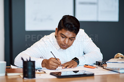 Buy stock photo Shot of an architect using a ruler to draw a building plan