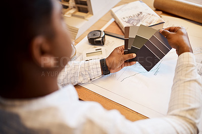 Buy stock photo Shot of an architect deciding on a colour scheme while working on a project