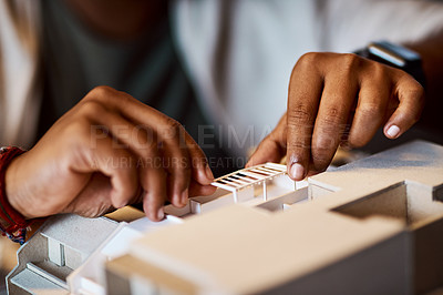 Buy stock photo Shot of an unrecognisable architect designing a building model in a modern office