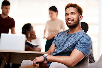 Buy stock photo Portrait of a confident young businessman sitting in an office