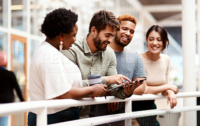 Buy stock photo Shot of a group of young creatives using a digital tablet together in an office