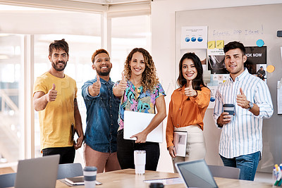 Buy stock photo Cropped portrait of a group of young designers giving thumbs up to the camera while standing in the boardroom of their office