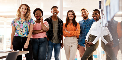 Buy stock photo Cropped portrait of a group of young designers standing in the boardroom of their office