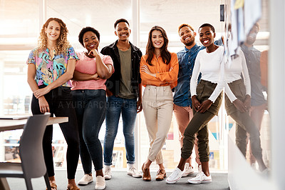 Buy stock photo Full length portrait of a group of young designers standing in the boardroom of their office