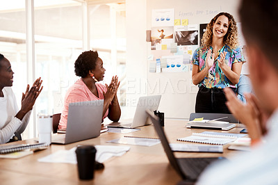 Buy stock photo Cropped shot of a group of young designer applauding during a meeting in the boardroom