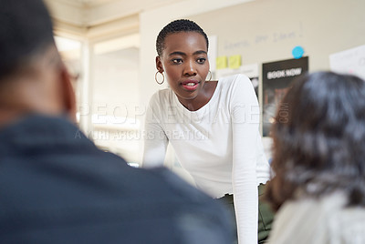 Buy stock photo Shot of a young businesswoman having a meeting with her colleagues in an office