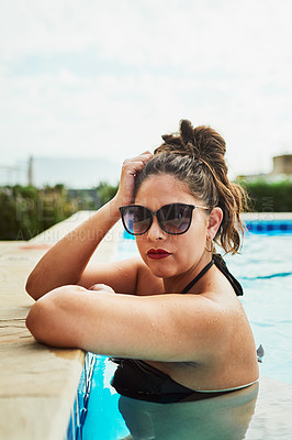 Buy stock photo Cropped shot of a young woman wearing sunglasses while relaxing in a swimming pool