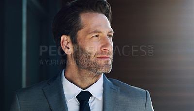 Buy stock photo Shot of a mature businessman looking thoughtful outside an office