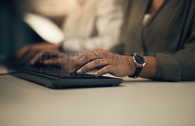 Buy stock photo Closeup shot of an unrecognisable businesswoman working on a computer in an office at night