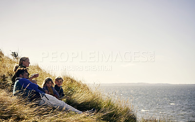 Buy stock photo Shot of a young couple out on an adventure together with their two kids