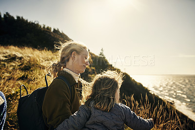 Buy stock photo Shot of a woman and her daughter out on an adventure