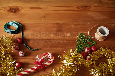 Buy stock photo High angle shot of various Christmas items on a wooden table at home