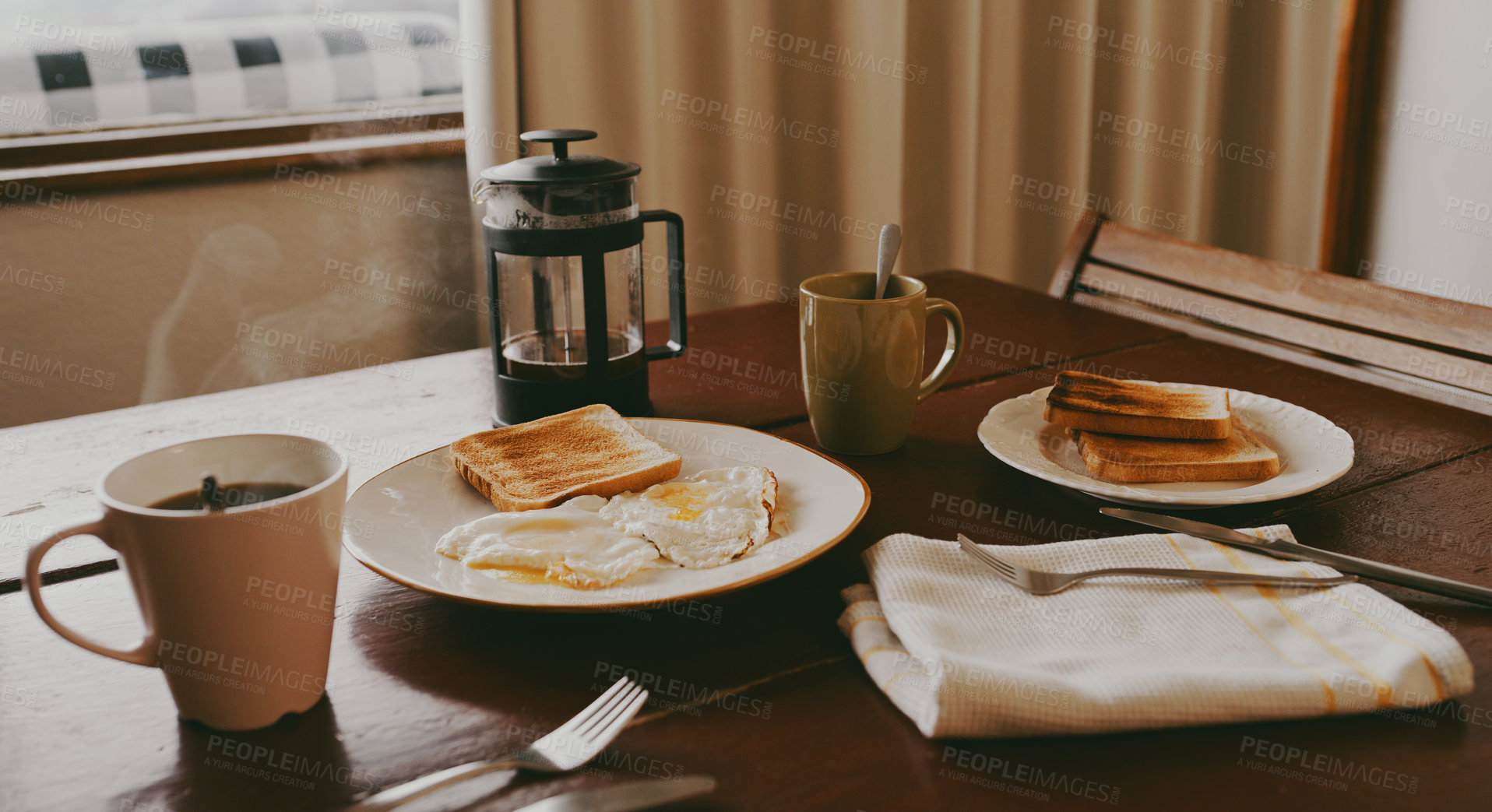 Buy stock photo Still life shot of breakfast and coffee on a dining table at home