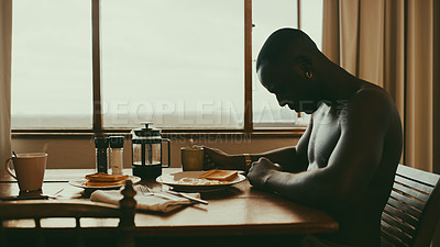 Buy stock photo Cropped shot of a young man having breakfast at home