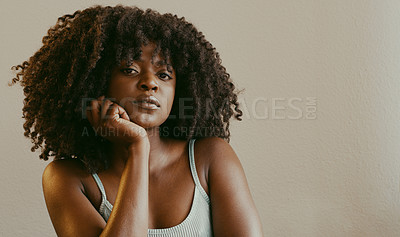 Buy stock photo Cropped shot of a beautiful young woman sitting at home