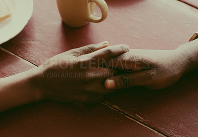Buy stock photo Cropped shot of an unrecognizable couple holding hands at a table