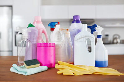 Buy stock photo Shot of various cleaning products on a table in the kitchen at home