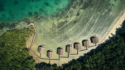 Buy stock photo High angle shot of bungalows along the island coasts of Indonesia