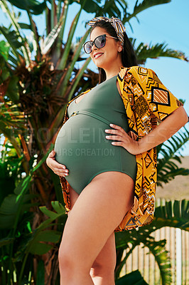 Buy stock photo Shot of a beautiful pregnant young woman spending a relaxing summer's day outdoors