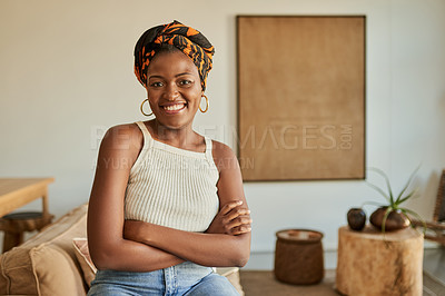 Buy stock photo Portrait of a confident young woman spending a relaxing day at home