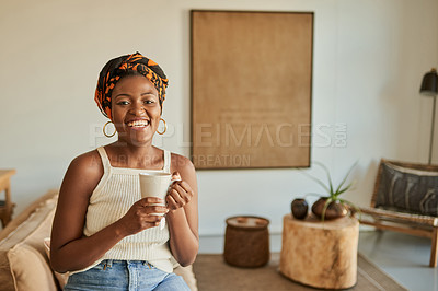 Buy stock photo Shot of a young woman having a warm beverage during a relaxing day at home